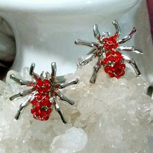 Silver spider cuff links with red rhinestones
